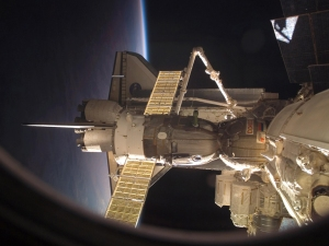 Space Shuttle Discovery and a Soyuz spacecraft are docked with the ISS.  Photo Credit:  NASA.
