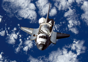 Space Shuttle Discovery approaching the ISS.  Photo credit:  NASA