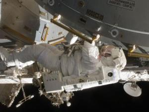 Astronaut Tim Kopra works on the Kibo laboratory during the first spacewalk.  Image Credit: NASA