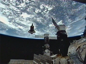 The shuttle Endeavour after undocking, directly behind and below the International Space Station on July 28th. (Credit: NASA TV)