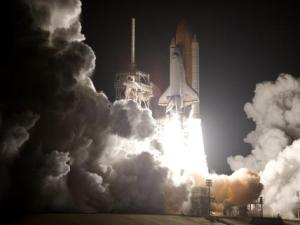 Discovery liftoffs from Launch Pad 39A at NASA's Kennedy Space Center in Florida on Friday night.  Image Credit: NASA/Sandra Joseph and Kevin O'Connell