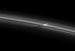 Puncture in Saturn's F Ring.  Image credit:  NASA