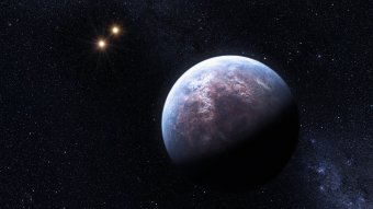 The newly discovered system Gliese 667 (Artist's impression).  Image credit:  ESO