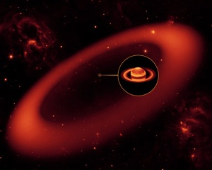 Artist's conception of the new ring.  The inset shows an enlarged image of Saturn, as seen by the W.M. Keck Observatory at Mauna Kea, Hawaii, in infrared light.  Image credit: NASA/JPL-Caltech/Keck